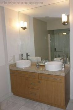 This Bathroom features new and unique sinks.  Along with the refaced Vanity this bathroom has a fresh new look!