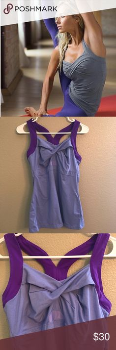 """Athleta Jaya Tank Athleta Jaya Tank Pansy Purple Heather Large 15 1/2""""pit to pit 26""""shoulder to bottom  Fabric and Care: Pilayo (Supplex Nylon/Lycra Spandex). Heathered Pilayo (Supplex Nylon/Polyester/Lycra Spandex) Wicks, breathes and keeps you dry Rated UPF 50+  Lightweight, soft, stretchy, smooth feel Machine wash and dry. Lends low support for A-D cups Built-in support reduces bounce and thwarts the headlights Twist front, racerback gives your arms freedom to move, wide straps won't dig…"""