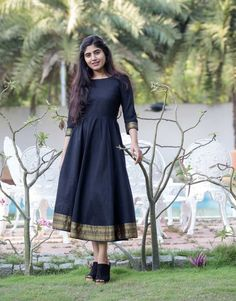 Black Mangalgiri Cotton Fit and Flare Dress from the house of The Anarkali Shop. Breezy Mangalgiri Cotton Fit and Flare Dress with Gathers and Zari Border Detailing Casual Gowns, Casual Frocks, Casual Wear, Long Gown Dress, Saree Dress, Dress Red, Frock Dress, Designer Kurtis, Indian Designer Outfits