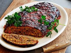 Bobby Flay's ground pork, veal and beef chuck blend is studded with chunks of zucchini and bell pepper. He ditches super-sweet ketchup for a tangy balsamic glaze, which gives the meatloaf a caramelized crust in the oven.