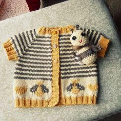 Baby Bee Cardigan, link to original sweater pattern, link to duplicate stitch bee chart, link to amigurumi crochet bee