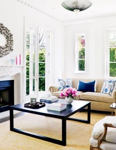 Living room: White fireplace with Black accent color