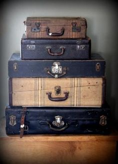 Stack old suitcases (thrift store) to make perhaps a side table.