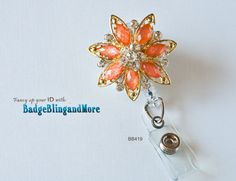 Elegant looking flower -Gold and Orange-  (clear)RETRACTABLE  Badge Holder/Swivel Reel/Spring Clip - Badge Clip BB419. $12.00, via Etsy.