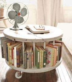 #upcycle an old spool and #repurpose it into a rotating bookshelf! LLOVE this!
