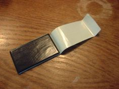 Duct tape on a old credit card - fix hems, shoes, luggage tears, leaky showers, etc.