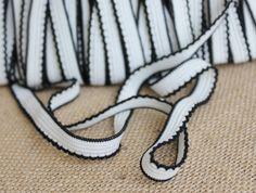Black and white elastic trim for a variety of sewing projects.