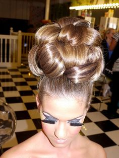 Sexy updo.  So high!  I'd love to see my pretty guy with his hair piled up like this someday.