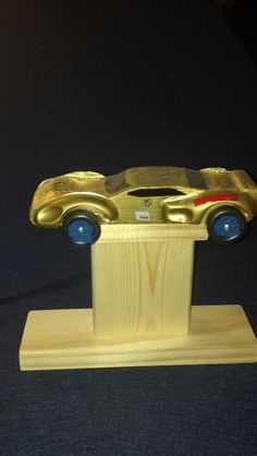 """Pinewood Derby Car stand. Base is 8"""" x 2 1/2"""" x 3/4"""" Middle is 3 1/2"""" x 3 1/2"""" x 1 1/2"""" Top is 4"""" x 1 1/2"""" x 3/4"""" Used 2 wood screws at the top and bottom to connect together."""