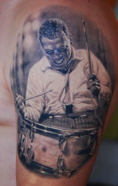 Den Yakovlev- two of my favorite things tattoos and drumming!