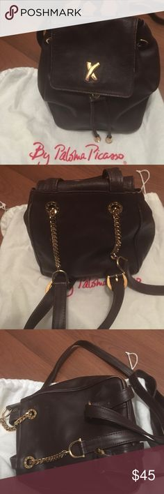 Brown leather backpack by Paloma Picasso Paloma Picasso iconic X leather back pack. Small size with drawstring closure. Wear on edges see pic. Condition consistent with age and use Paloma Picasso Bags Backpacks