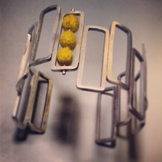 Abacus cuff bracelet with mustard felted wool and patina fade. by Cara Romano