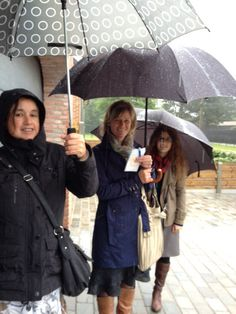 my sisters preaching in the rain. Belgium , they are so brave! I am the one in the middle