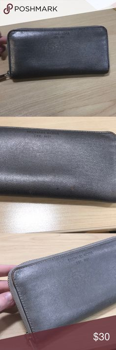 Michael kors zip around wallet vintage Older style Michael kors. It's a gunmetal color with silver zipper. Zipper works perfect. Some patina on the outside. Still very functional and will last forever. Sold as is, please see photos before purchasing. Michael Kors Bags Wallets