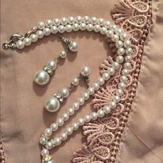 Vtg: Set of pearl earrings and necklace. Pearl dangling earring with some crystal stones . Necklace is with silver tone locket for closure.Mew w/o tag. Jewelry Necklaces