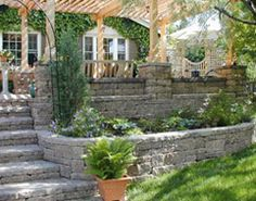Stone terraced retaining wall adds texture and function to your back yard.