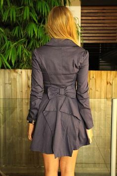 Trench coat with a bow. It adds a nice feminine touch to a more menswear-styled garment