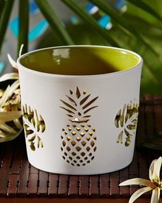 Punched Pineapple Tea Light Holder From Tommy Bahama - incorporates both the pineapple and monsterra of HSH branding.