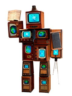 """Nam June Paik, """"Li Tai Po"""" (1987), 10 antique wooden TV cabinets, 1 antique radio cabinet, antique Korean printing block, antique Korean book, 11 color TVs, 96 x 62 x 24 in. (243.8 x 157.5 x 61 cm), Asia Society, New York: Gift of Mr. and Mrs. Harold and Ruth Newman (photo © 2007 John Bigelow Taylor Photography, courtesy Asia Society, New York)"""