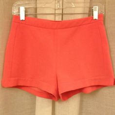 Coral high waist dress shorts Super cute flat front coral dress shorts with little shorts underneath.  Side zip closure. I wore these once to a wedding shower and had them dry cleaned, but as I was listing I did notice a little spot as shown in picture. Forever 21 Shorts