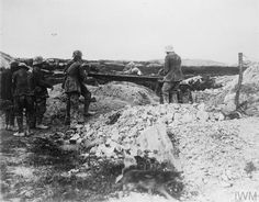 THE BATTLE OF PASSCHENDAELE, JULY-NOVEMBER 1917 - Hill 70 (Lens) 15-25 August: A stretcher case being brought in by German prisoners.