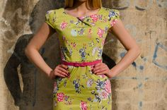 Green color dress with floral print and pink belt by Be Chic Fashion
