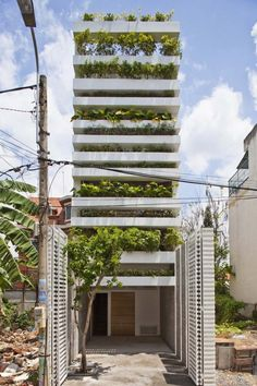 This garden home in Sagon has a great lush view from the outside and inside. A very unusual idea for nature in a small space!