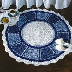 """Blue Plate Special Rug Crochet ePattern - Number of Designs: 1 rugApproximate Design Size: 40"""" in diameterDesigner: Leisure Arts StaffOriginal Publication: Crochet With Heart magazine, April 1993 issueSkill Level: Easy †Description: This fabric-strip rug is reminiscent of the dishes Grandmother loved so much. Inspired by the same pretty blue and white china, our crocheted """"plate"""" rug will be a welcome addition to any spot that needs warmth and cheer. It is crocheted using 100% cotton fabric…"""