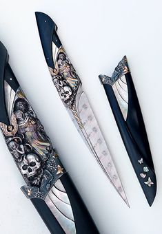 Arpad Bojtos knife. Made of damasteel, various metals, ebony, and mother of pearl.