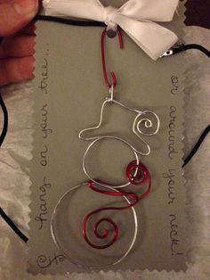 Wire snowman. Can be hung as tree ornament or necklace pendant: