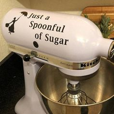 This is a non permanent vinyl decal featuring a silhouette of the Disney character, Mary Poppins. Beside it says Just a Spoonful of Sugar. The design is pictured on a Kitchenaid Mixer but it can be applied elsewhere, such as a wall, or storage box. You can choose to have the design in