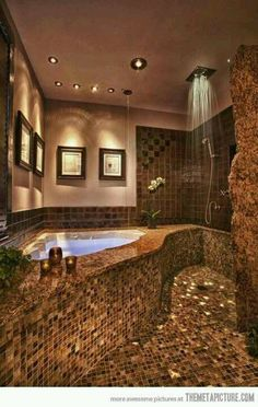 Stone walk-in shower with corner tub.. More