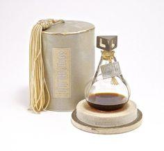 1928 Lentheric Asphodele perfume bottle, clear glass, silver gilt and enamel stopper, hangtag label, box. 2 3/4 in.