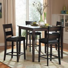 The transitional design of the Ethan Collection allows for versatile placement in a number of casual dining settings. The wide slat back chairs feature black bi-cast vinyl seating that compliments the heavily burnished finish.