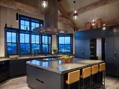 I love the stone,  the openness,  and the wood beams!