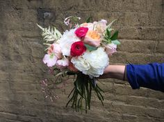 Seasonal peony bouquet featuring accent color ranunculus and garden roses!