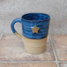 Hand thrown stoneware mug with a star