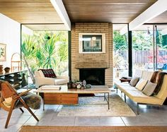 We love that travertine-topped coffee table, by Paul McCobb. See more mid-century modern houses, click on the image.