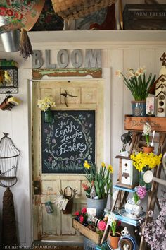 """The Earth laughs in Flowers"" Chalkboard Door in Potting Shed | homeiswheretheboatis.net #spring #garden #chalkboard"