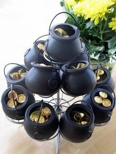 Pots of Gold...I gave this for a treat with gold Kisses, Reeses, Rolos and green foil wrapped chocolate balls.