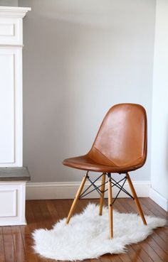 100% original early design by Eames. Manufactured by Herman Miller, Venice, California.  PKW design wire form chair on birch dowel legs. Leather cover