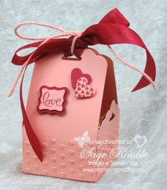 The Scalloped Tag Topper Punch makes a sweet treat holder.  Handmade gifts are the best for holidays, and you'll love this 3D paper craft project for any occasion ... you could even hide Easter eggs or a Mother's Day trinket inside it.  www.stampingmadly.com