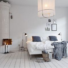 Pleeaaasseeee can i move in here...????? Ahhh. That fireplace. #Scandi love BIG time...x GI --- image courtesy of www.digsdigs.com #Scandinavian #bedrooms #interiors #whitebedrooms #homewares #fireplaces #style by greenhouseinteriors presented by SuperiorCustomLinens.com