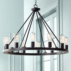 Offering a modern twist on industrial design, this contemporary chandelier is stunningly shade-free. Black Iron Chandelier, Round Chandelier, Iron Chandeliers, Rustic Chandelier, Chandelier Shades, Rustic Lighting, Chandelier Lighting, Edison Bulb Chandelier, Chandelier Ideas