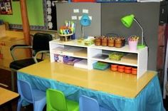 Shoe shelves on table to make a writing center - cute!