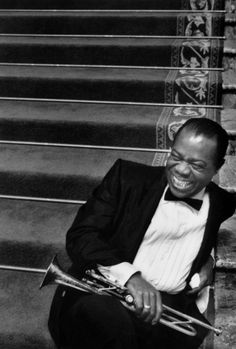 Louis Armstrong (August 1901 – July Satchmo or Pops, was an American jazz trumpeter, singer, and an influential figure in jazz music.Louis Armstrong on the MGM set of 'High Society', 1956 Louis Armstrong, Music Icon, My Music, Humphrey Bogart, Jazz Musicians, Famous Musicians, Jazz Blues, High Society, Black And White