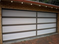 Aluminium frame with Mini-Orb inserts. Custom Garage Doors, Garage Door Design, Custom Garages, Sectional Garage Doors, Laser Cut Panels, Design Your Own, Blinds, Custom Design