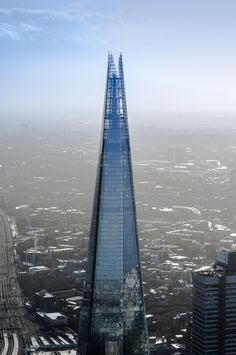 Renzo Piano's Shard—a 95-story pyramidal skyscraper that resembles a shard of glass—towers over the city of London. | archdigest.com