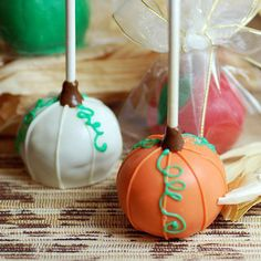 pumpkin cake pops. dip stick in chocolate then orange