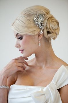 Beautiful up do with rhinestone fascinator. Fabulous!